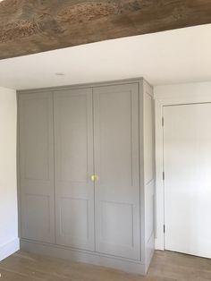 Grey wardrobes in farmhouse