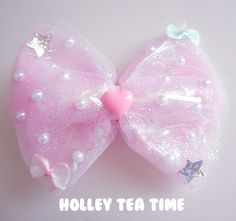 """☆ A holographic iridescent dream*¨*•.¸¸⋆*✩  ☆ cute hair bow and pin  ☆ made from magical glitter tulle ,holographic film / cellophane, iridescent bows and stars  ☆ size: 13 cm x 10.5 cm (5.1"""" x 4.1"""")  ☆ bows, and false pearls glued on bow  ☆ iridescent fairy bows and plastic heart  ☆ Brooc..."""