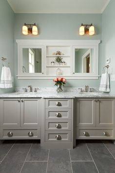 Master bathroom with double vanity, marble countertop, mint walls, slate tile…