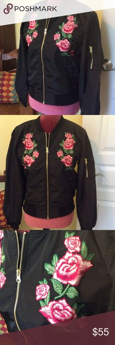 Love Tree floral bomber jacket Black bomber jacket with pink embroidered flowers on front.  Elastic waist and cuffs.  Gold tone zipper.  Adorable! Aluna Levi Jackets & Coats
