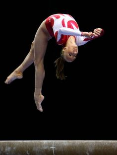 ♂ Sports Adventure - Nastia Liukin (USA) performing a layout step-out on the balance beam