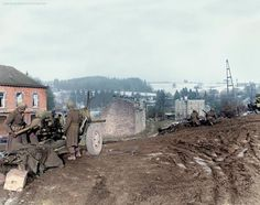 A US 7th Armored Division 3-inch M5 towed antitank gun covers the approach road near the Railroad crossing at Vielsalm, Belgium. 23rd of December 1944