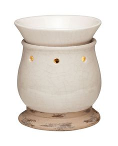 Contenta Mid-Size #Scentsy Warmer    Soothing, organic tones of cream and tan and a simple shape bring contentment to any space.    Your Price: £30.00