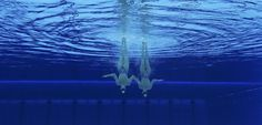 Russia's Natalia Ishchenko and Svetlana Romashina are seen underwater as they perform in the synchronised swimming duets.