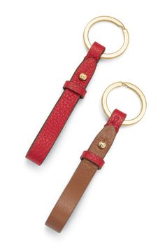 Keep your story with you while you're on the go with this reversible, pebbled leather Key Fob. Available in 3 color variations: Rose Gold/Gunmetal, Black/Chestnut, and Holiday Red/Nutmeg.