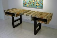 Wow, here we have a delightful pallet plan for the refurbishing of your house area. This fantastic table with black color base is artistically designed with the unique transformation and settlement of pallet wood slats in various forms. You can locate this table in any area of your house for renovation and table need purposes.