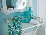 I love the blue glass bottles. And it's hard to see, but I like the mirror too.  HGTV Dream Home 2013