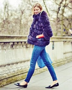 Candice Lake of Candice Lake wearing a purple fur jacket, skinny jeans, and black pointy toe flats