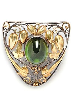 Arts & Crafts Green Tourmaline Brooch, Frank Gardner Hale, the tourmaline cabochon set amongst gold and silver scrolling foliate devices | JV
