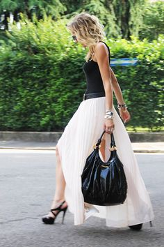We can't get enough of long pleated skirts this summer! Featuring a Miu Miu bag and Zara skirt.