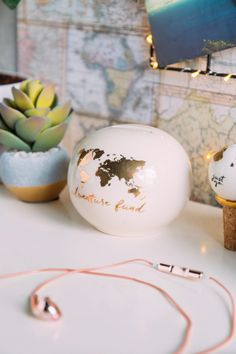 8 Wanderlust Products That Will Inspire You to Travel Before Summer is Over: An adventure fund bank to help you save up for your next trip.