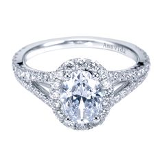 Or this setting - split shank oval halo ring... But with at least 6 prongs over the main diamond