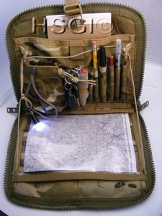 "HSGI: Modular Admin Pouch - The ""MAP"" measures 10 1/2"" wide X 9"" tall X 1"" in thickness ( Thickness may very depending on contents placed within ) . There is 4 rows of MOLLE/PALS webbing with 6 columns across . A 1"" side release buckles on top to provide a quick closure and adjustable cord-lock/draw string for quick closure or adjustable shelf for des"
