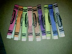 Crayola wrappers on clothespins. Modge podge craft. Perfect to.hang my sons art up with.