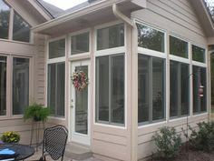Narrow porch, screens, low knee wall, transoms above. Screened In Patio, Outside Patio, Enclosed Porches, Decks And Porches, Sunroom Office, Glass Porch, Porch Enclosures, Four Seasons Room, Porch Wall