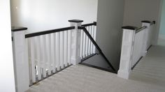 Custom newel posts and caps for balcony and stair handrails.