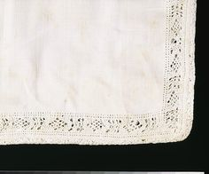 Pillow case made in Britain 1600-1700  linen with bobbin-lace insertions and whitework embroidery.