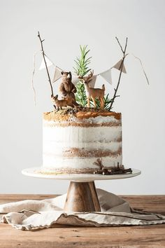 """If you are totally intimidated by cake decorating, this simple naked cake is beautiful and forgiving. Try these decorating tips for making a """"naked cake."""" kindergeburtstag 10 Tricks to a Naked Cake - She Holds Dearly Food Cakes, Boys First Birthday Cake, Cake Birthday, Birthday Kids, Birthday Month, Boy Birthday Parties, Nake Cake, Woodland Cake, Cake Smash"""