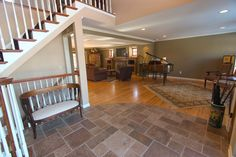9638_E | I like the transition from tile to wood flooring. Very nicely done. See more great pictures at the site!