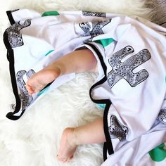 Our Cactus Swaddle is lightweight, cotton stretch jersey. 110x80cmPrinted with our original artwork, Cactus is black with a green feature spot and black edging. Please email for international shipping enquiries.