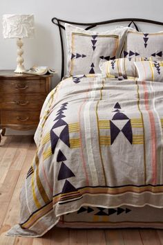 In love with this bedding. Neutral yet with a statement