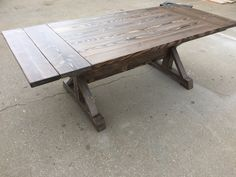 Evoli trestle style table with leaf extensions installed, Stained with Evoli unique stain that is one of a kind, custom build your table.... find us on Facebook Evoli Furniture