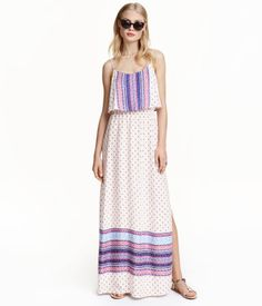 Maxi dress in a patterned viscose weave with a wide flounce at the top, narrow adjustable shoulder straps, an opening with a button at the back of the neck, an elasticated seam at the waist and slits in the sides.