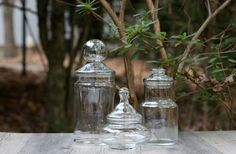 Set of Three Clear Glass Apothecary Jars with Lids / Candy Jars, Bathroom Storage Jars / Terrarium Jars by theretrobeehive on Etsy https://www.etsy.com/listing/210385960/set-of-three-clear-glass-apothecary-jars