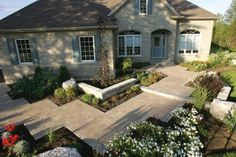 Well designed angular entrance with Unilock Stonehenge paver and Brussels Dimensional garden wall