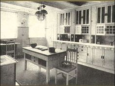 1920s kitchen style - cupboards with glass  I really like kitchens that look like this. It would be awesome to have my kitchen look like that.