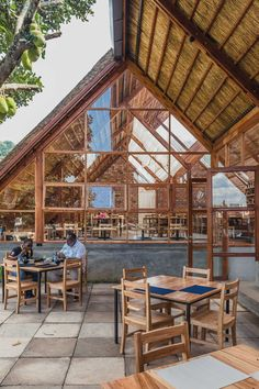 Yamasen Japanese Restaurant | TERRAIN architects #Concrete #construction #Steel #Structure #TERRAIN #TERRAINarchitects #TimothyLatim #Uganda Restaurant Exterior Design, Roof Structure, Steel Structure, Book Restaurant, Wooden Facade, Shelter Design, Uganda, Thatched Roof, Roof Design