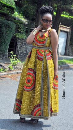 African print fit and flare maxi dress in brown, mustard, red and cream hues. It has a full skirt with box pleats and side pockets. It is fully lined with a zip at the back. The style of the dress giv Long African Dresses, Latest African Fashion Dresses, African Print Dresses, African Print Fashion, Africa Fashion, Ankara Fashion, 70s Fashion, Spring Fashion, Style Fashion
