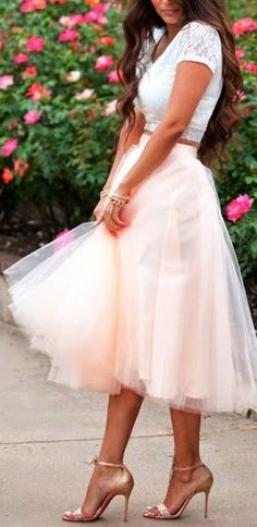 Adorable! Soft peach toned tulle with a white crop top and nude heels…romantic and fun