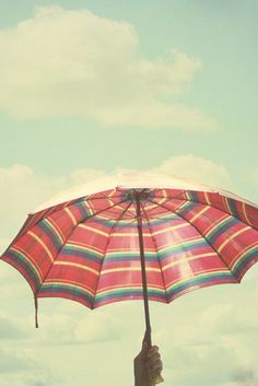 under an umbrella, love the colours :) reminds me of the beach and sitting under the umbrella hiding from the suns harsh rays