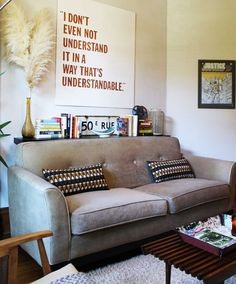 I like the LACK floating shelf behind the sofa to create a bit of space here
