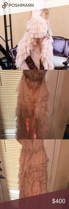 Sherri hill high low prom Sherri hill light pink high low prom dress.Zip up corset dress with beading throughout top of dress.The dress also features ruffles and ostrich feathers throughout.Very beautiful dress,worn once to the marine corps ball. Sherri Hill Dresses Prom