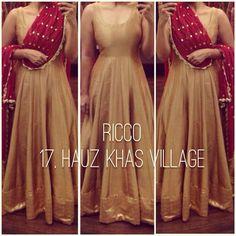 Golden gown cum floor length anarkali suit.