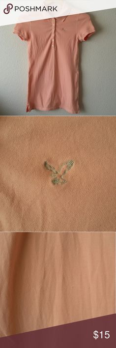 American Eagle Outfitters peach polo American Eagle Outfitters The Eagle Polo in size medium. Lovely light peach color. Has slight pilling down the front (please see photo). In good condition. American Eagle Outfitters Tops Tees - Short Sleeve