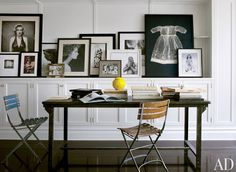 I like the idea of a shelf with framed photos/images in black and white of varying sizes (but generally fairly large)