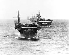 US Navy Task Group 38.3 entering Ulithi anchorage in a column following strikes in Philippine Islands 24 December 1944. Ships from the front: Langley (CVL-27) Ticonderoga (CV-14) Washington (BB-56) North Carolina (BB-55) South Dakota (BB-57) Santa Fe (CL-60) Biloxi (CL-80) Mobile (CL-63) and Oakland (CL-95). Photo taken from Essex (CV-9).