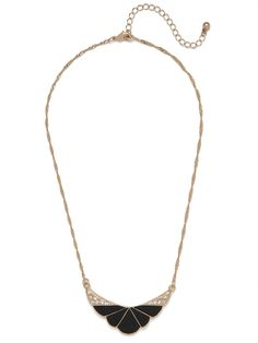 Tap into the glorious Jazz Age with this beautiful necklace, which features a gorgeous shell motif crafted from glossy black enamel and glittering crystals. We love it.
