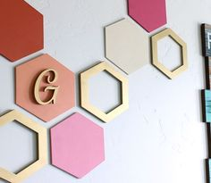 Use wooden craft shapes for this simple geometric wall decoration.