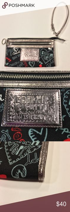 "Coach Poppy Graffiti Red Silver Black wristlet Coach Poppy Graffiti Heart Metallic Trim Zip Wallet Wristlet Black Red silver. Condition is Pre-owned. No flaws noted. Minor scuffs on zipper pulls. Both zippers work.   Measures 7.5"" across 4.5"" top to bottom  5.5"" drop on strap 6 card slots Coach Bags Clutches & Wristlets"