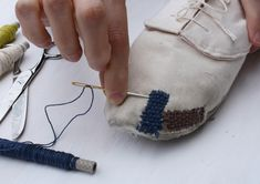 Repair It Yourself shoes by Eugenia Morpurgo - darn your shoes to stop your toes peeping out. Fashionable AND useful!