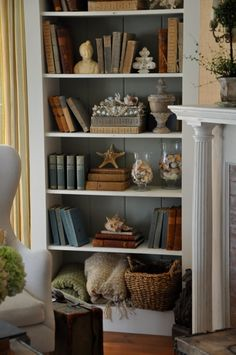 Bookcase display shelves, with books and other lovely items.   Brooke's home, Velvet & Linen Blog.