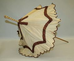 Parasol   American   The Met Date:1870s Culture:American Medium:silk, wood Credit Line:Gift of Mr. William Drown Phelps, 1943 Accession Number:C.I.43.29.3