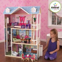 Uniquely adorable, this KidKraft Storybook Mansion Dollhouse provides hours of fun and imaginative play. Be ready to watch your little ones jump for joy when they see this KidKraft Storybook Mansion Dollhouse set up in the play room. Dollhouse Kits, Wooden Dollhouse, Wooden Dolls, Girls Dollhouse, Four Rooms, Multiplication For Kids, Play Houses, Doll Houses, Hanging Plants