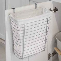 Wastebasket that hangs on cabinet door for pop-up camper.