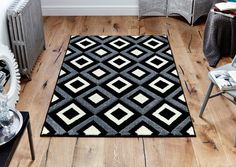 Viva Geometric Rug is a perfect way to add both style and value to your décor. #blackrugs #geometricrugs #largerugs #designerrugs