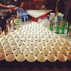 BLACK OUT BEER PONG  5v5 ; 100 cup vs 100 cup ; 30 rack of beers each side.  you can only get balls back if everyone in your team makes a cup.  you can only get a re-rack on 25 & 10 cups.   rewards  the losing team has to buy the winning team an another 30 pack.
